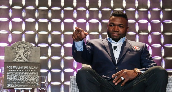 BOSTON - May 19, 2016 - David Ortiz sits next to his Red Sox Hall of Fame Memorable Moment plaque at the Red Sox Hall of Fame and Fenway Honors Award Gala. (Brita Meng Outzen/Boston Red Sox)