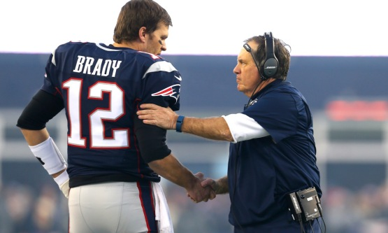 FOXBORO, MA - JANUARY 16: Tom Brady #12 and head coach Bill Belichick of the New England Patriots shake hands at the start of the AFC Divisional Playoff Game against the Kansas City Chiefs at Gillette Stadium on January 16, 2016 in Foxboro, Massachusetts. (Photo by Maddie Meyer/Getty Images)